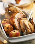Roast capon with stuffing and apples