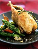 Stuffed quail with green asparagus