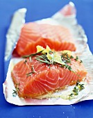 Preparing a thick piece of salmon to be cooked in aluminium foil