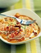 Small casserole dish of Dublin Bay prawns with chanterelles