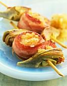 Scallop,bacon and artichoke skewers