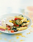 Sliced chicken breasts with penne and southern vegetables