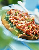 Spinach and diced bacon pizza