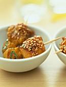 Fruit skewers with sesame seeds