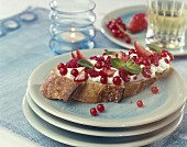 Whipped cream ,summer fruit and mint on a slice of bread