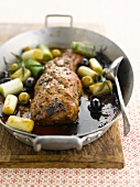Saddle of pork glazed with balsamic vinegar,olives and leeks