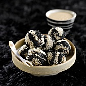 Beef meatballs coated with golden and black sesame seeds