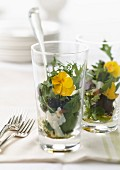 Fancy mixed salad with parmesan flakes and flowers