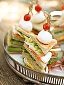 Smoked salmon club sandwiches