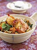 Sauteed noodles with scampis,coriander and ginger