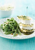 Green beans with pine nuts , goat's cheese and pesto mille-feuille