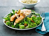 Salmon steak with dried fruit , broccoli and romanesco cabbage salad