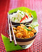 Calamaries in sweet and sour sauce, rice with spicy hot peppers