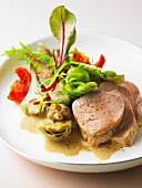 Veal Filet mignon, purple artichoke fricassée with confit tomatoes and creamy morel sauce