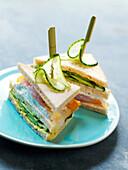 Salmon and green tomato club sandwich