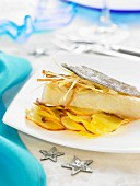 Salt-cod fillet with cava, thinly sliced leeks and sauteed potatoes