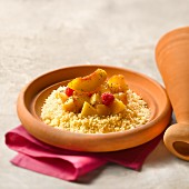 Peach and raspberry Tajine with jasmin-flavored semolina