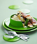 Cod fillets with raw ham and rice