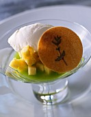 Cream of kiwi soup with diced pineapple, ice cream and thyme cookie