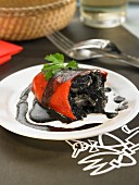 Red peppers stuffed with squid cooked in their ink