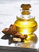 Bottle of argan oil and argan nuts