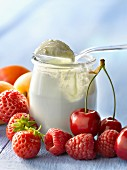 Open yoghurt in a glass pot and fruit