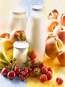 Yoghurts in glass pots,milk in glass bottle and fruit
