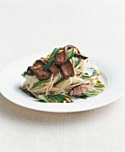 Noodles with beef, mint and hazelnuts