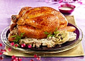 Roast capon with white sausage stuffing
