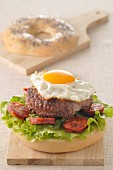 Hamburger,fried egg and Chorizo bagel burger