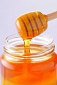 Honey spoon and jar of honey