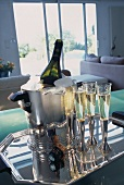Glasses of Champagne and bottle of Champagne in an ice bucket