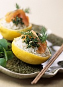 Lemons stuffed with salmon sushis