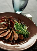 Grilled duck Magret with chicory of Trévise