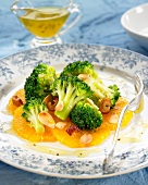 Broccoli salad with oranges and thinly sliced almonds