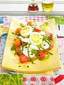 Tomato, mozzarella, hard-boiled egg and green asparagus salad