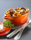 Casserole dish of beef and carrot stew