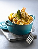 Casserole dish of rabbit with confit citrus,fennel and bay leaves