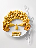 Plate of appetizers and popcorn in the shape of a face