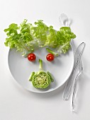 Plate of salad in the shape of a face