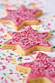Star-shaped shortbread cookies with pink icing