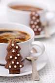 Cup of coffee and Christmas tree-shaped chocolate