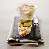 Potted pork on sliced bread with gherkins