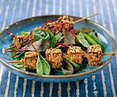 Marinated tofu coated with sesame seed brochettes