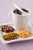 Cup of coffee and three different flavored crunchy cookies