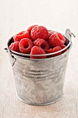 Small metal bucket of raspberries