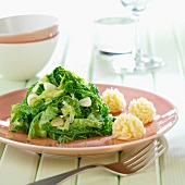 Green curly cabbage with flower-shaped mashed potatoes