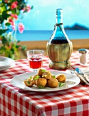 Rice and pea Croquettes on a terrace in Sicily