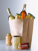 Jars and bottles in a brown paper bag