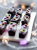 Small chocolate log cakes decorated with Smarties